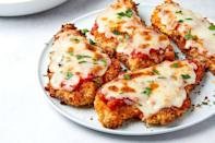 """<p>Get your Italian-American restaurant favorite without all the fuss.</p><p><em><a href=""""https://www.delish.com/cooking/recipe-ideas/a35256979/air-fryer-chicken-parmesan-recipe/"""" rel=""""nofollow noopener"""" target=""""_blank"""" data-ylk=""""slk:Get the recipe from Delish »"""" class=""""link rapid-noclick-resp"""">Get the recipe from Delish »</a></em></p>"""