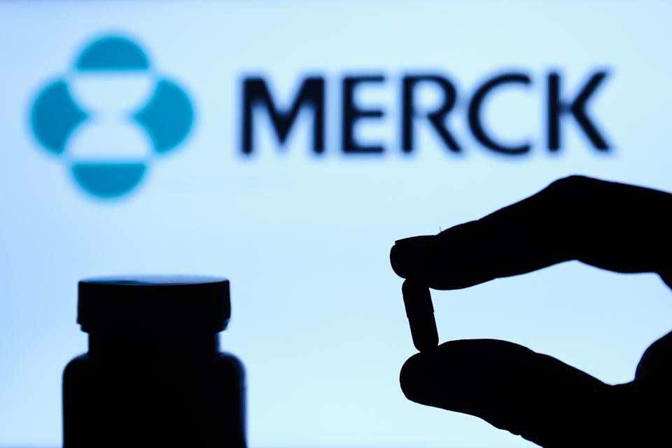 Medicine pill is seen with Merck logo displayed on a screen in the background in this illustration photo taken in Poland on October 4, 2021. (Photo by Jakub Porzycki/NurPhoto via Getty Images)