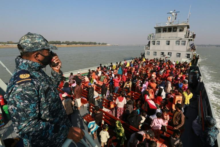 Rohingya refugees sit on a Bangladesh navy ship as they are relocated to the flood-prone island of Bhashan Char in the Bay of Bengal on Tuesday