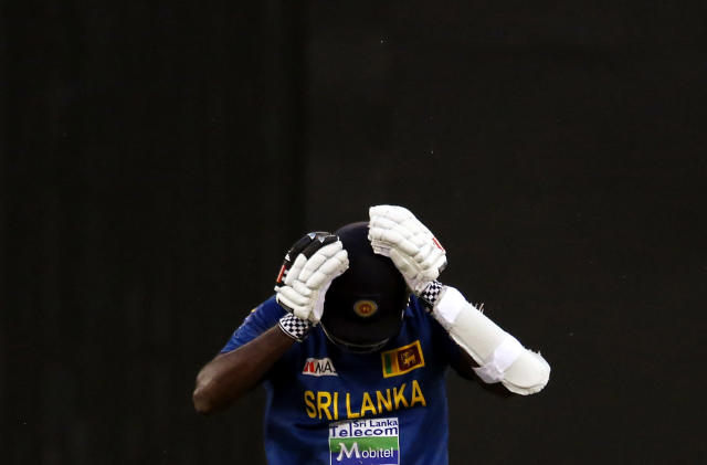 Sri Lanka's Angelo Mathews reacts after he was run out for 12 runs during their one-day international cricket match against Australia at the Melbourne Cricket Ground January 11, 2013. REUTERS/David Gray (AUSTRALIA - Tags: SPORT CRICKET TPX IMAGES OF THE DAY)