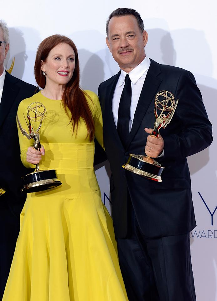 """Julianne Moore, winner Outstanding Lead Actress in a Miniseries or a Movie for """"Game Change,"""" and producer Tom Hanks, winner Outstanding Miniseries or TV Movie for """"Game Change,"""" pose in the press room at the 64th Primetime Emmy Awards at the Nokia Theatre in Los Angeles on September 23, 2012."""