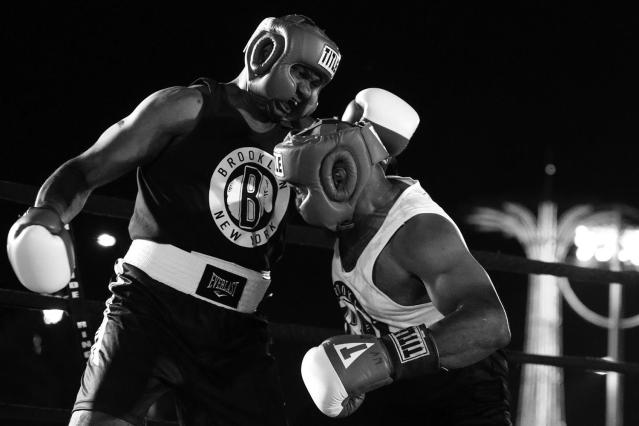 <p>Wayne Lowe and Brian Davis, both from the 28th Precinct in Harlem, mix it up during a grudge match at the Brooklyn Smoker in the parking lot of Gargiulo's Italian restaurant in Coney Island, Brooklyn, on Aug. 24, 2017. (Photo: Gordon Donovan/Yahoo News) </p>