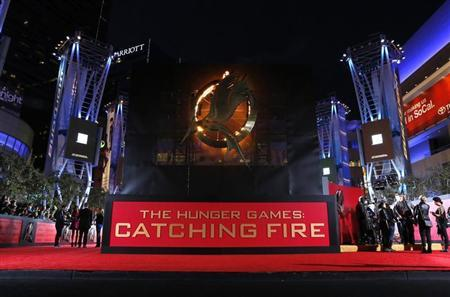 """People wait at the premiere of """"The Hunger Games: Catching Fire"""" in Los Angeles"""