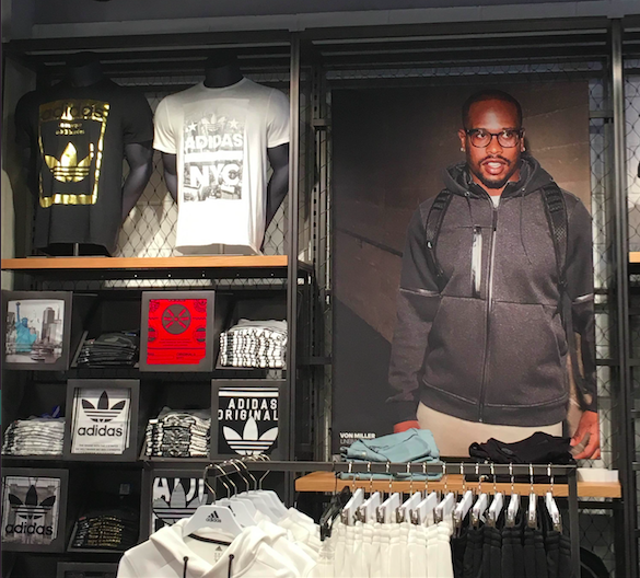 A wall in the Adidas concept shop, with a poster of NFL player Von Miller