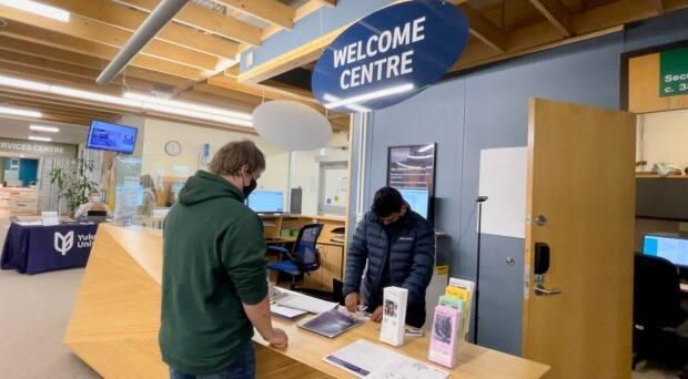 A Yukon University student is welcomed to the Whitehorse campus last week, ahead of the 2021 fall semester. Classes begin on Tuesday. (Wayne Vallevand/CBC - image credit)