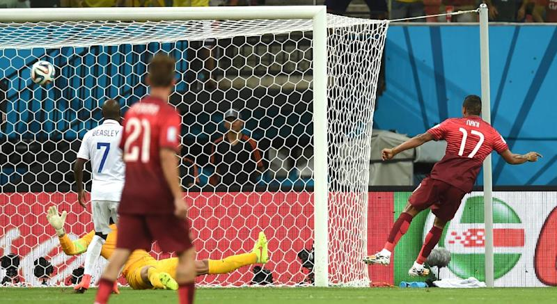 Portugal's Nani, right, scores the opening goal during the group G World Cup soccer match between the USA and Portugal at the Arena da Amazonia in Manaus, Brazil, Sunday, June 22, 2014