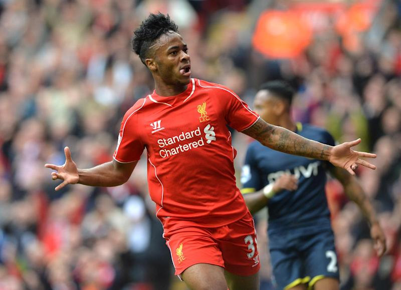 Liverpool's midfielder Raheem Sterling celebrates scoring the opening goal during the English Premier League football match between Liverpool and Southampton on August 17, 2014 (AFP Photo/Paul Ellis )