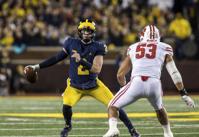 FILE - In this Oct. 13, 2018, file photo, Michigan quarterback Shea Patterson (2) tries to scramble away from Wisconsin inside linebacker T.J. Edwards (53) during the second quarter of an NCAA college football game in Ann Arbor, Mich. Patterson and the Wolverines face Penn State this week. (AP Photo/Tony Ding, File)