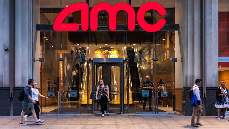 CHICAGO, ILLINOIS - JULY 10, 2018 - Entrance to AMC River East 21 Theaters, sittuated on 322 East Illinois Street during evening hours with people walking.