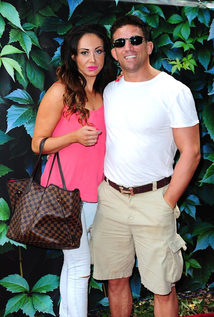 Nikki Manashe and Alex Reid attend a gala performance of Alice's Adventures in Wonderland in Holland Park, London. (Photo by Ian West/PA Images via Getty Images)