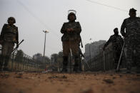 Indian paramilitary soldiers stand guard at an area that saw violence on Tuesday in New Delhi, India, Wednesday, Feb. 26, 2020. At least 20 people were killed in three days of clashes in New Delhi, with the death toll expected to rise as hospitals were overflowed with dozens of injured people, authorities said Wednesday. The clashes between Hindu mobs and Muslims protesting a contentious new citizenship law that fast-tracks naturalization for foreign-born religious minorities of all major faiths in South Asia except Islam escalated Tuesday. (AP Photo/Altaf Qadri)