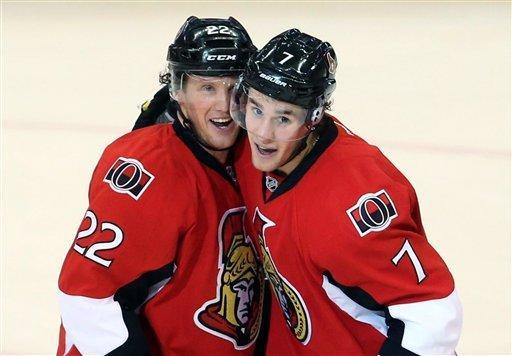 Ottawa Senators' Erik Condra (22) celebrates his goal with Kyle Turris (7) against the Buffalo Sabres during the second period of their NHL hockey game, Tuesday, Feb. 12, 2013, in Ottawa, Ontario. (AP Photo/The Canadian Press, Fred Chartrand)