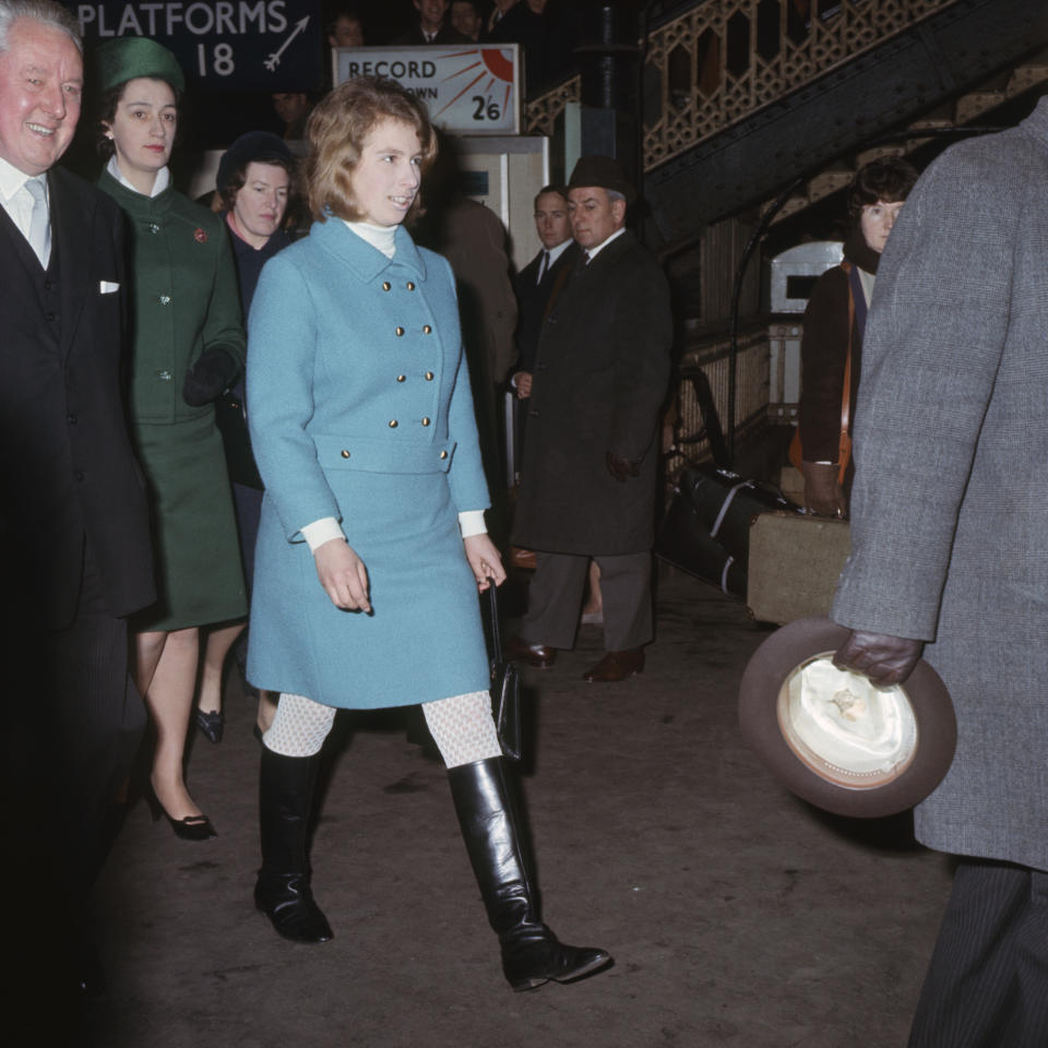 Princess Anne, in double-breasted jacket, boots and open work stockings, in London in 1967. While the boots were on trend, they were also a nod to her love of all things equestrian. (PA)