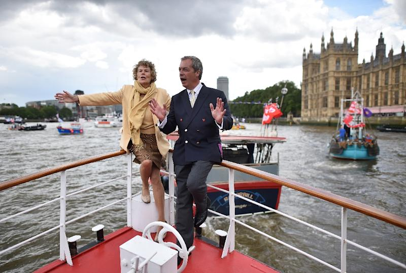 UK Independence party leader Nigel Farage (R) and Labour party MP Kate Hoey accompany a flotilla of fishing boats on the River Thames on June 15, 2016 as they campaign for a Brexit (AFP Photo/Ben Stansall)