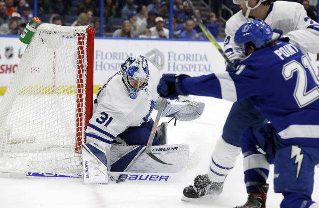 Toronto Maple Leafs goaltender Frederik Andersen (31) makes a stick save on a shot by Tampa Bay Lightning center Brayden Point (21) during the second period of an NHL hockey game Thursday, Dec. 13, 2018, in Tampa, Fla. (AP Photo/Chris O'Meara)
