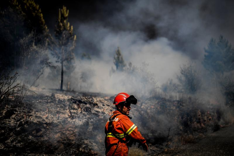 A firefighter is at work to extinguish a wildfire at Roda village in Macao, central Portugal on July 21, 2019. (Photo: Patricia De Melo Moreira/AFP/Getty Images)