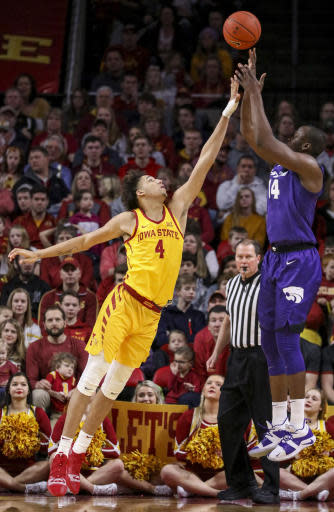 Iowa State forward George Conditt IV tries to block the shot of Kansas State forward Makol Mawien during the first half of an NCAA college basketball game, Saturday, Jan. 12, 2019, in Ames, Iowa. (AP Photo/Justin Hayworth)
