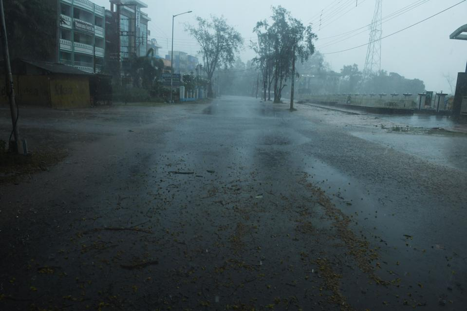 A deserted road is seen ahead of the expected landfall of cyclone Amphan in Digha, West Bengal, on May 20, 2020. - India and Bangladesh began evacuating more than two million people on May 18 as a cyclone barrelled towards their coasts, with officials racing to ready extra shelters amid fears of coronavirus contagion in cramped refuges. (Photo by Dibyangshu SARKAR / AFP) (Photo by DIBYANGSHU SARKAR/AFP via Getty Images)