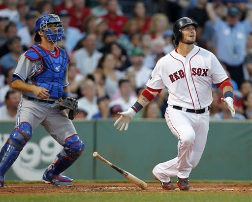 Boston Red Sox's Jarrod Saltalamacchia, right, watches his three-run home run in front of Toronto Blue Jays' J.P. Arencibia in the second inning of a baseball game in Boston, Saturday, July 21, 2012. (AP Photo/Michael Dwyer)