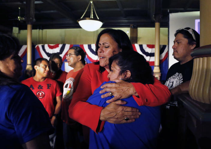 Democratic state Sen. Angela Giron hugs a crying supporter after giving her concession speech after she lost in a recall vote in Pueblo, Colo., Tuesday Sept. 10, 2013. Two Colorado state lawmakers who backed gun-control measures in the aftermath of the mass shootings in Colorado and Connecticut last year have been ousted in recall elections. (AP Photo/Brennan Linsley)