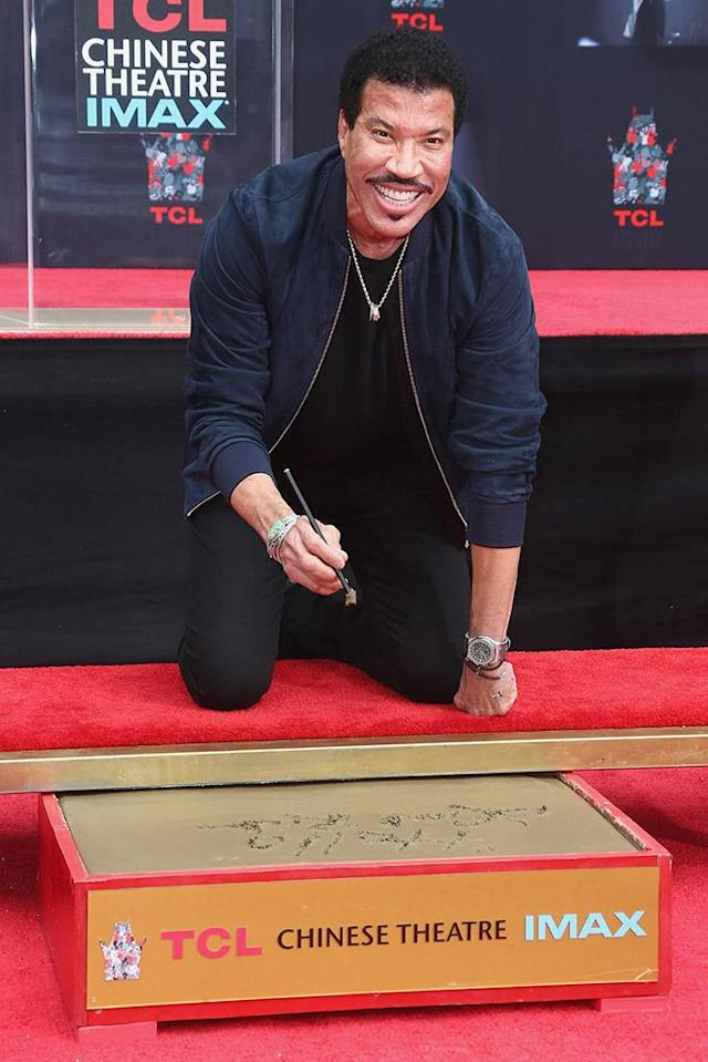 <p>The new <em>American Idol</em> judge flashed a killer smile as he was celebrated with a Hand And Footprint Ceremony at theTCL Chinese Theatre in Hollywood, Calif. on Wednesday. (Photo: Tommaso Boddi/Getty Images) </p>