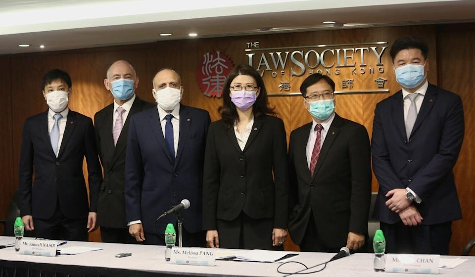 Law Society president Melissa Kaye Pang (third right) had said the closure of the firm was necessary to protect its clients. Photo: Jonathan Wong