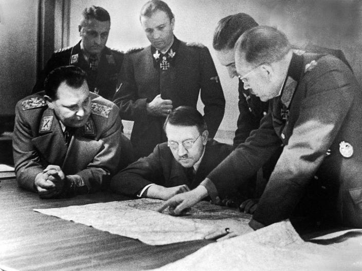 """Adolf Hitler (center, in glasses) and members of his General Staff review plans for 'Operation Bodenplatte' (also known as 'the Great Blow'), an airstrike in support of the Ardennes offensive, late 1944.<span class=""""copyright"""">Heinrich Hoffman/The LIFE Picture Collection—Getty Images</span>"""