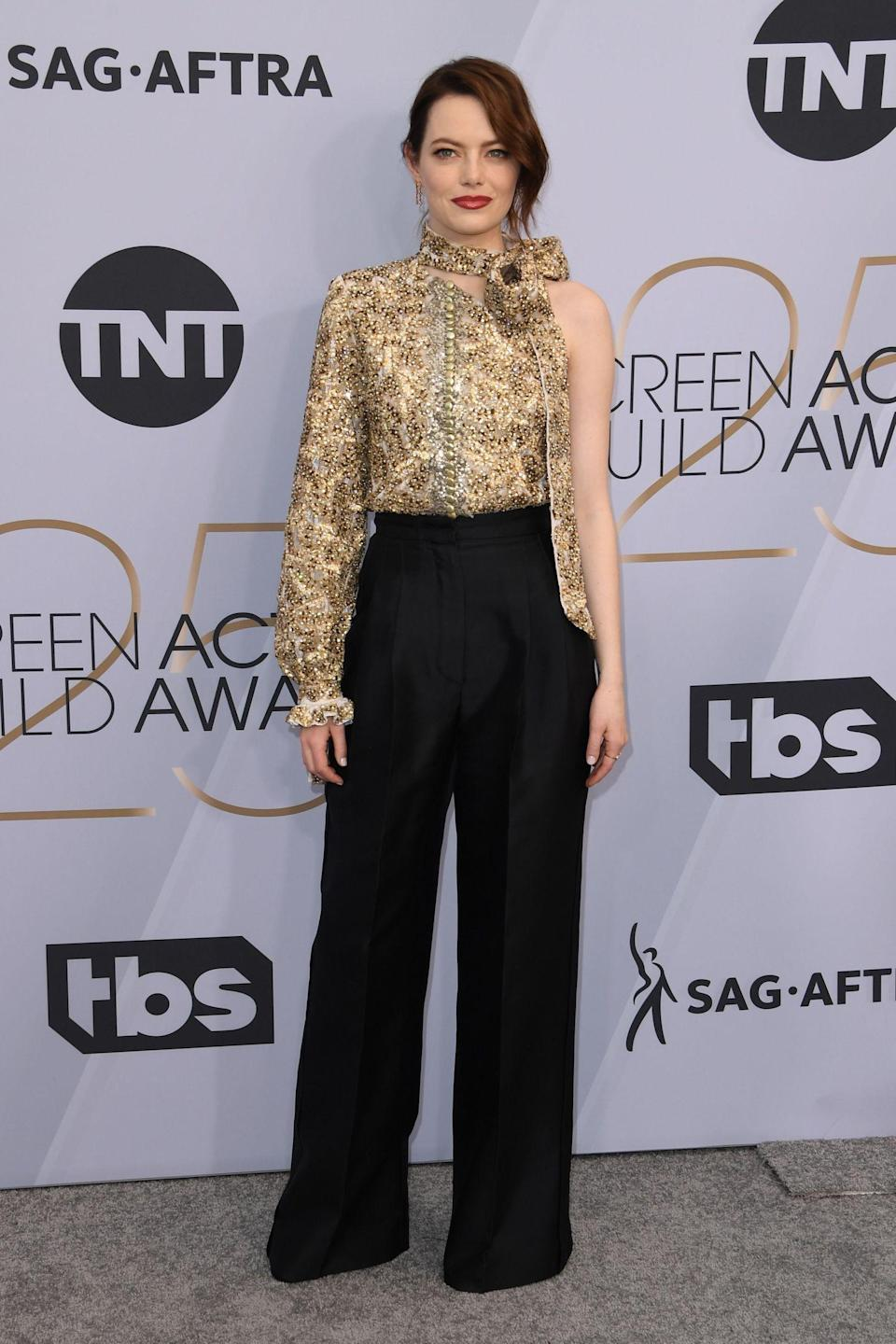 """<p>Emma Stone wore head to toe Louis Vuitton to the SAG ceremony. <em>The Favourite</em> actress was hilariously <a rel=""""nofollow noopener"""" href=""""https://people.com/tv/sag-awards-2019-megan-mullally-opening-monologue-emma-stone/"""" target=""""_blank"""" data-ylk=""""slk:targeted"""" class=""""link rapid-noclick-resp"""">targeted</a> by Megan Mullalay at the top of the show. """"To SAG nominee, the beautiful Emma Stone, who just turned 30. Our condolences. You had a great run, like a really great run,"""" Mullally joked. """"Extra good. But we're looking forward to your reverse mortgage loan commercials. They're going to be great."""" (Photo: Getty Images) </p>"""