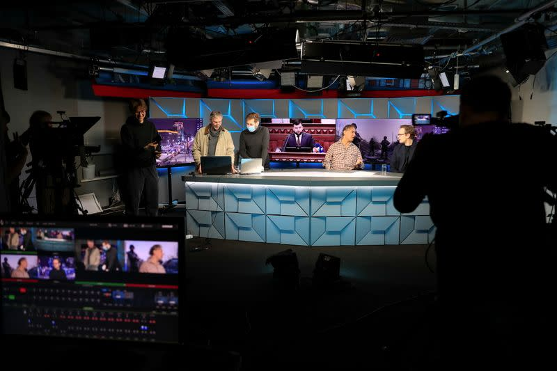 FILE PHOTO: Journalists work in the studio of Radio Free Europe/Radio Liberty broadcaster in Moscow