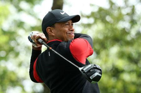 FILE PHOTO: Tiger Woods of the U.S. hits off the second tee during final round play of the 2018 Masters golf tournament at the Augusta National Golf Club in Augusta, Georgia, U.S. April 8, 2018. REUTERS/Lucy Nicholson