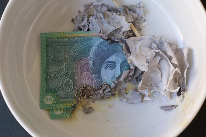 Pictured: Burnt Australian banknote. Image: Getty