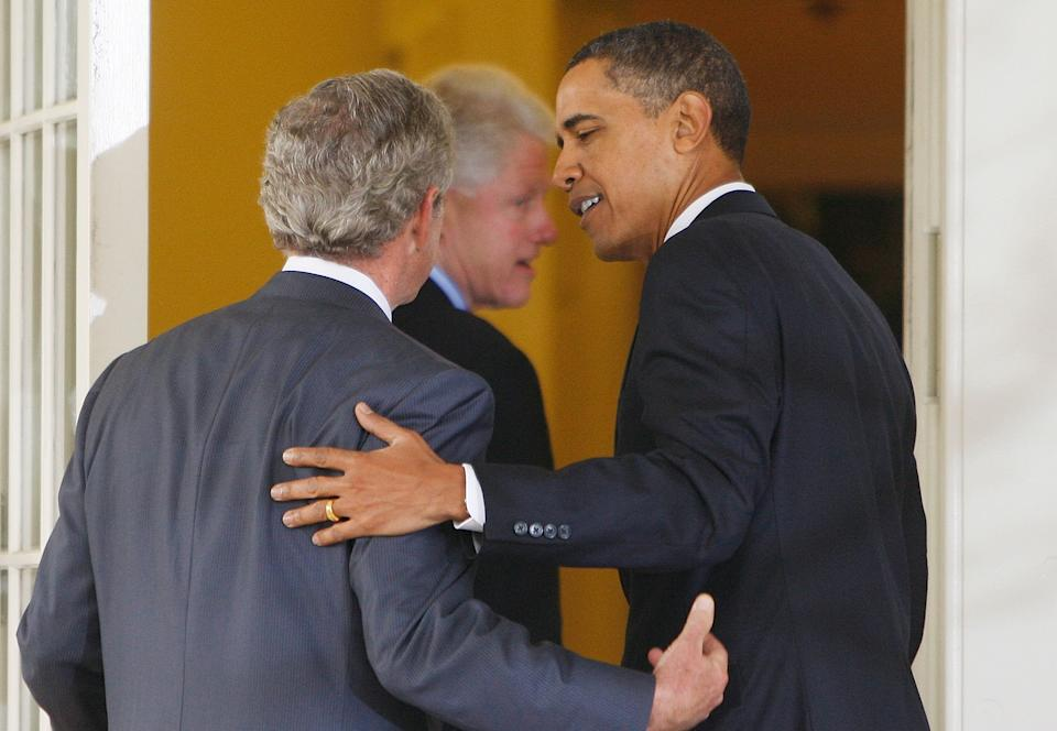 President Barack Obama walks into the Oval Office with former President George W. Bush, left, and former President Bill Clinton, center, Saturday, Jan. 16, 2010, after they spoke in the Rose Garden of the White House in Washington. Bush and Bill Clinton have been picked by Obama to help with U.S. relief efforts after the earthquake in Haiti.  (AP Photo/Ron Edmonds)