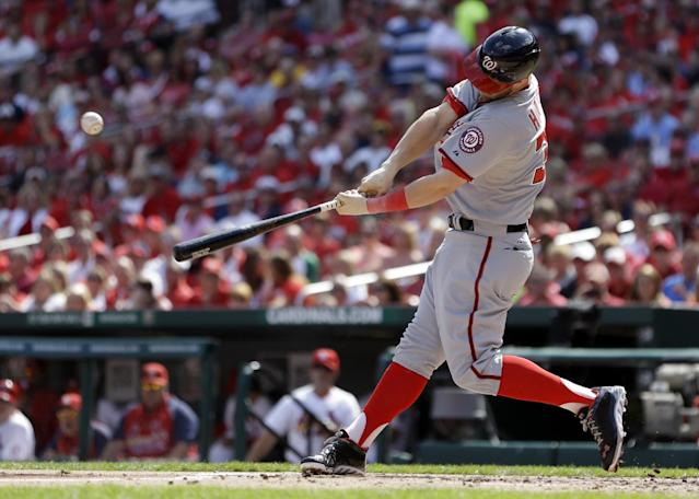 Washington Nationals' Bryce Harper hits an RBI-single during the first inning of a baseball game against the St. Louis Cardinals Wednesday, Sept. 25, 2013, in St. Louis. (AP Photo/Jeff Roberson)