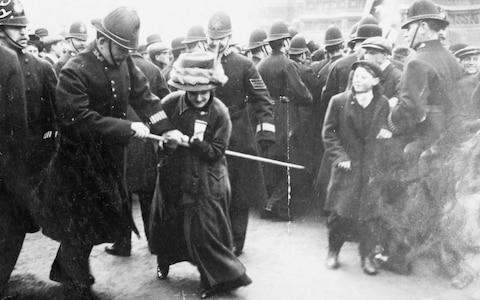 A suffragette struggling with a policeman on 'Black Friday', Westminster, London, 18th November 1910. The Conciliation Bill (which would have given the vote to women who occupied premises for which they were responsible) was shelved by the Prime Minister, Herbert Asquith. On learning of this, the Women's Social and Political Union marched on the House of Commons, a riot followed and the women were assaulted - some being severely beaten - by police and others. The newspaper Votes for Women reported that 115 women and 4 men were arrested. The WSPU quickly learned the lessons of that day and a policy decision was made to pursue their campaign using different tactics. Large deputations were considered to be too dangerous and from this moment the suffragettes went underground and waged 'guerrilla warfare' (their phrase) against the Liberal Government. (Photo by Museum of London/Heritage Images/Getty Images) - Credit: Heritage Images/© Museum of London / Heritage-Images