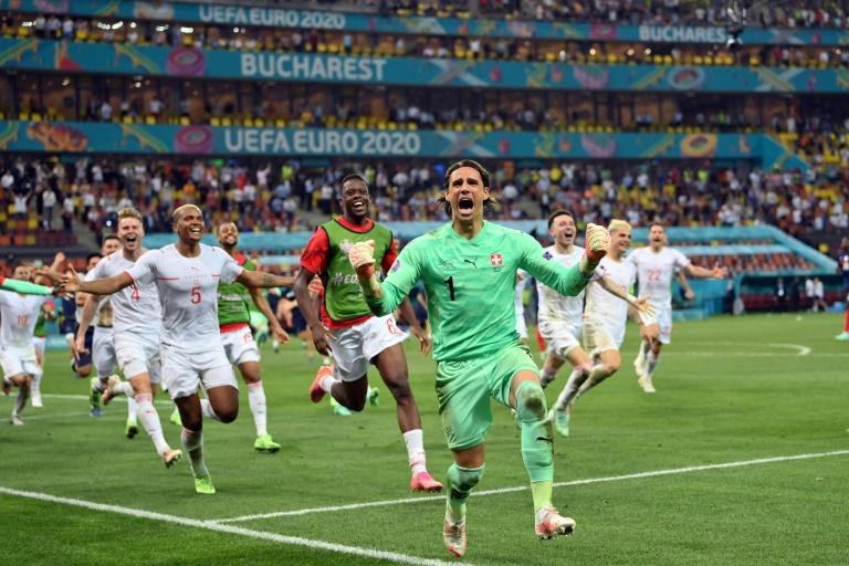 Yann Sommer leads the Swiss celebrations after saving Kylian Mbappe's penalty in the shootout