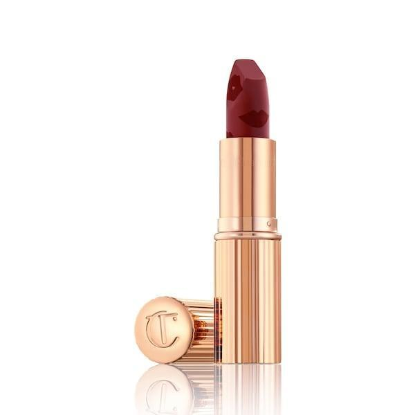 <p>The <span>Charlotte Tilbury Matte Revolution Lipstick in Scarlet Spell</span> ($34) is a univerally flattering shade that will be the finishing touch to a stunning look.</p>