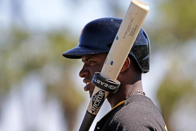 Pittsburgh Pirates' Gregory Polanco waits his turn to face live pitching during the team's baseball spring training workout in Bradenton, Fla., Thursday, Feb. 20, 2014. (AP Photo/Gene J. Puskar)