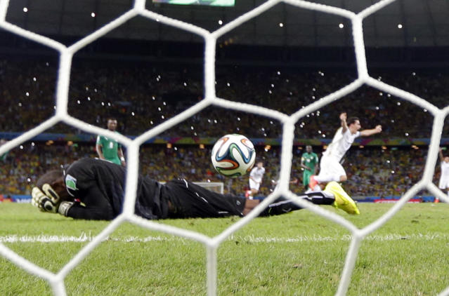 Greece's Giorgos Samaras, right, celebrates scoring his side's second goal from the penalty spot during the group C World Cup soccer match between Greece and Ivory Coast at the Arena Castelao in Fortaleza, Brazil, Tuesday, June 24, 2014. (AP Photo/Fernando Llano)
