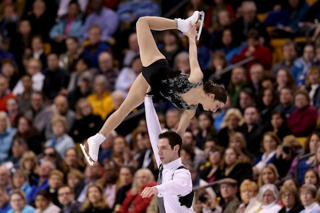 BOSTON, MA - JANUARY 11: Marissa Castelli and Simon Shnapir skate in the pairs free skate during the Prudential U.S. Figure Skating Championships at TD Garden on January 11, 2014 in Boston, Massachusetts. (Photo by Matthew Stockman/Getty Images)