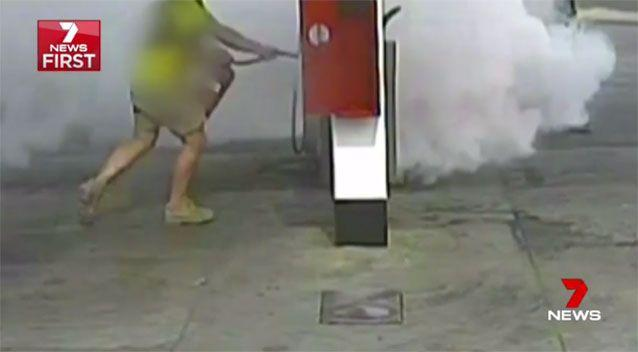 The tradie chases the would-be arsonist and douses him with fire retardent foam. Pictures: 7 News