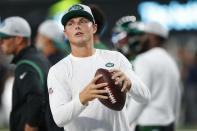 New York Jets quarterback Zach Wilson warms up before an NFL preseason football game against the Philadelphia Eagles Friday, Aug. 27, 2021, in East Rutherford, N.J. (AP Photo/Noah K. Murray)