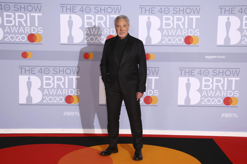 Singer Tom Jones poses for photographers upon arrival at the Brit Awards 2020 in London, Tuesday, Feb. 18, 2020. (Photo by Joel C Ryan/Invision/AP)