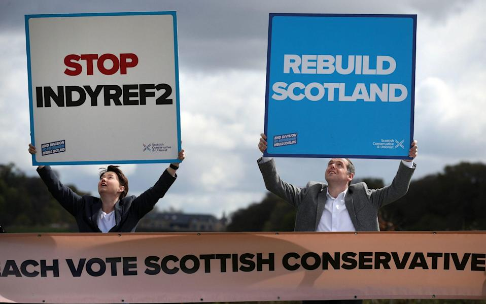 Scottish Conservative leader Douglas Ross with Ruth Davidson as they hold placards in front of Stirling Castle during campaigning for the Scottish Parliamentary election - Andrew Milligan/PA
