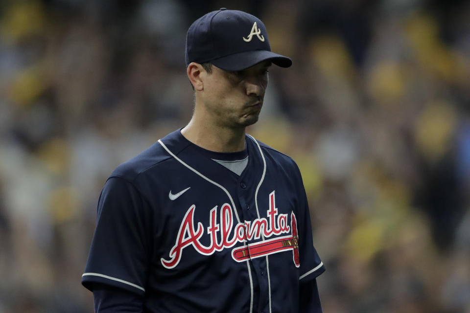 Atlanta Braves starting pitcher Charlie Morton reacts after leaving the game against the Milwaukee Brewers during the seventh inning in Game 1 of baseball's National League Divisional Series Friday, Oct. 8, 2021, in Milwaukee. (AP Photo/Aaron Gash)