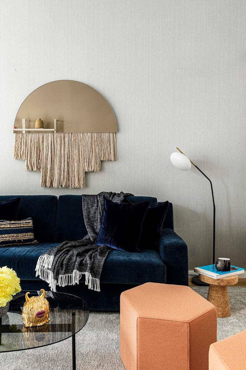 Here in the playroom/guest room is a golden Half Moon Mirror by Ben and Aja Blanc that has both whimsy and chic.