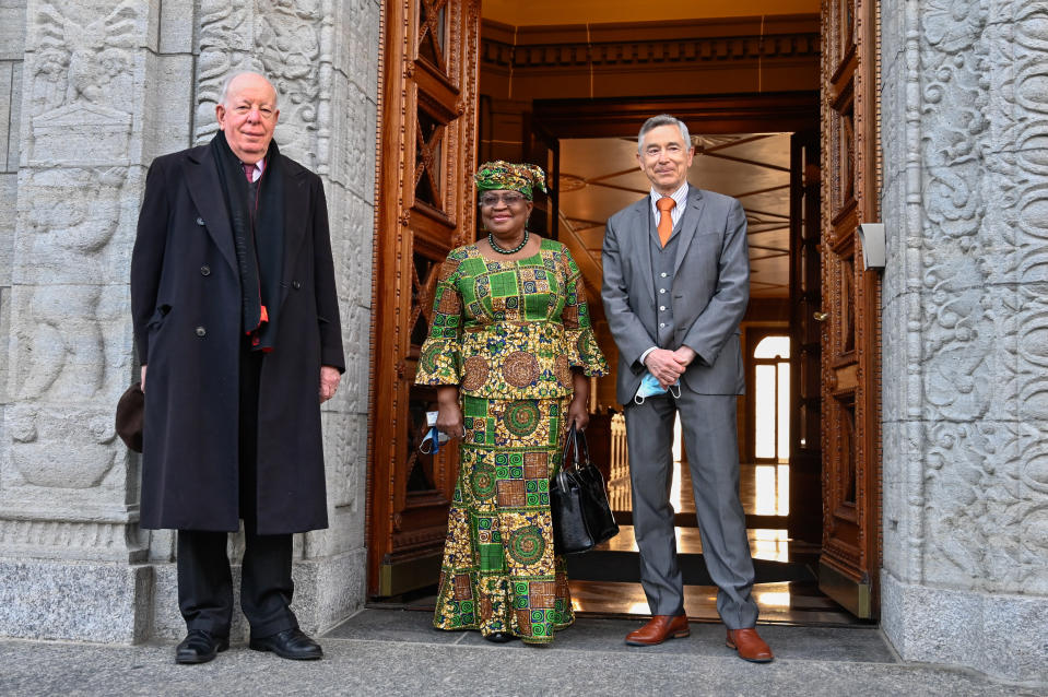 New Director-General of the World Trade Organisation Ngozi Okonjo-Iweala, center, poses between WTO Deputy Directors-General Alan Wolff, left, and Karl Brauner upon her arrival at the WTO headquarters to takes office in Geneva, Switzerland, Monday, March 1, 2021. Nigeria's Ngozi Okonjo-Iweala takes the reins of the WTO amid hope she will infuse the beleaguered body with fresh momentum to address towering challenges and a pandemic-fuelled global economic crisis. (Fabrice Coffrini/Pool/Keystone via AP)