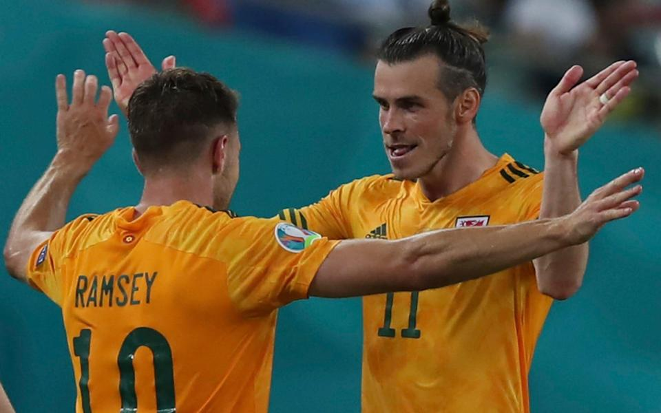 Wales' Aaron Ramsey, left, celebrates with his teammate Gareth Bale after scoring his side's opening goal during the Euro 2020 soccer championship group A match between Turkey and Wales - AP