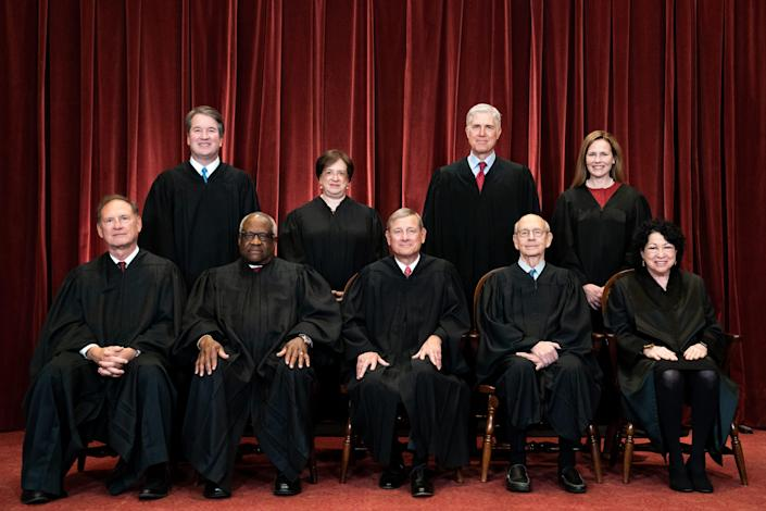Members of the Supreme Court pose for a group photo at the Supreme Court in Washington, DC on April 23, 2021. Seated from left: Associate Justice Samuel Alito, Associate Justice Clarence Thomas, Chief Justice John Roberts, Associate Justice Stephen Breyer and Associate Justice Sonia Sotomayor, Standing from left: Associate Justice Brett Kavanaugh, Associate Justice Elena Kagan, Associate Justice Neil Gorsuch and Associate Justice Amy Coney Barrett.