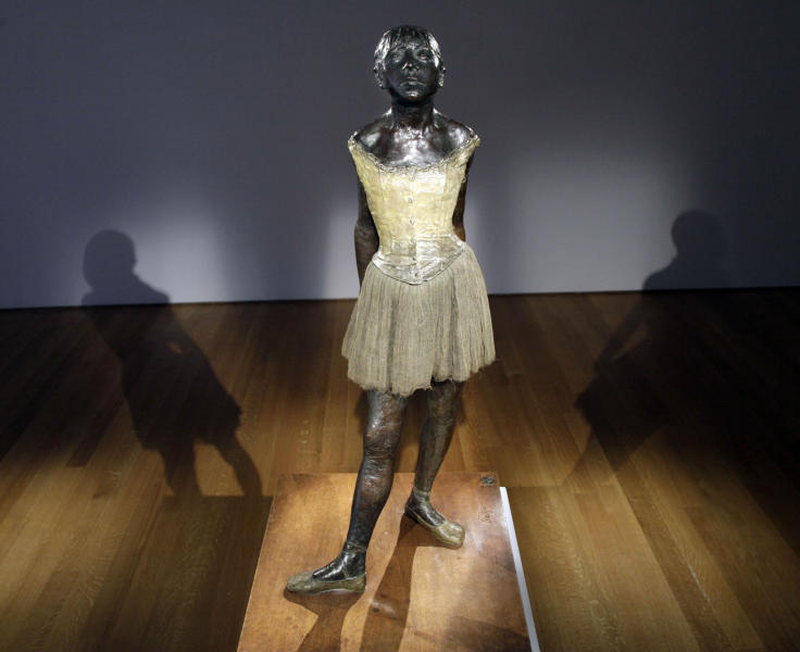 "FILE - In a Tuesday, Oct. 25, 2011 file photo, Edgar Degas ""Little Dancer Aged Fourteen"" is displayed at Christie's auction house, in New York. The bronze sculpture failed to find a buyer at Christie's New York auction of impressionist and modern art Tuesday night, Nov. 1, 2011. The sculpture had a pre-sale estimate of $25 million to $35 million, but there were no bids.  (AP Photo/Richard Drew, File)"
