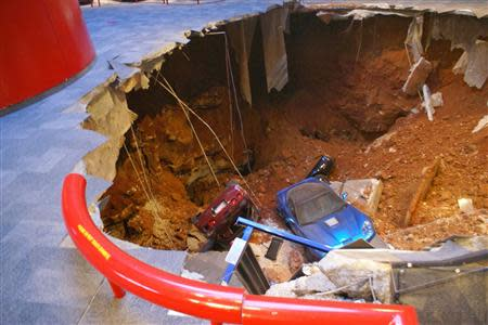 A 40-foot sinkhole that opened up under the National Corvette Museum and swallowed eight Corvettes, including the historic 1992 White 1 Millionth Corvette, in Bowling Green, Kentucky February 12, 2014 is seen in this handout provided by the museum. REUTERS/National Corvette Museum/Handout via Reuters